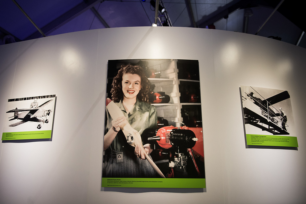 """30206010A - DRONES - Norma Jeane Mortenson, later known as Marilyn Monroe, is seen working on an OQ-2 Radioplane at the """"Drones: Is the Sky the Limit?"""" exhibit at the Intrepid Sea, Air, and Space Museum in New York, NY on May 9, 2017."""