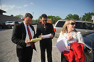 Paul Kevin Curtis (center), who had been in custody under suspicion of sending ricin-laced letters to President Barack Obama and others, looks over papers with attorneys Hal Nielson (left) and Christi McCoy before a news conference following his release Tuesday, April 23, 2013 in Oxford, Miss. The charges were dismissed without prejudice, which means they could be re-instated if prosecutors so choose.