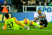 Jose Salomon Rondon (#9) of Newcastle United watches as his shot goes beyond the sliding Asmir Begovic (#27) of Bournemouth but drifts just outside the far post during the Premier League match between Newcastle United and Bournemouth at St. James's Park, Newcastle, England on 10 November 2018.