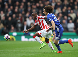 Saido Berahino of Stoke City (L) and David Luiz of Chelsea in action - Mandatory by-line: Jack Phillips/JMP - 18/03/2017 - FOOTBALL - Bet365 Stadium - Stoke-on-Trent, England - Stoke City v Chelsea - Premier League
