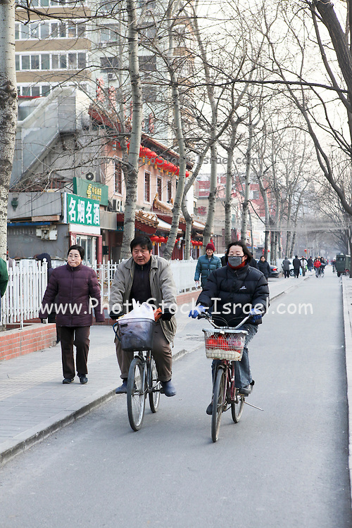 China, Beijing, Bicycle riders