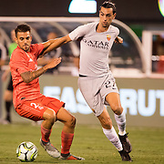 MEADOWLANDS, NEW JERSEY- August 7: Javier Pastore #27 of AS Roma and Dani Ceballos #24 of Real Madrid challenge for the ball during the Real Madrid vs AS Roma International Champions Cup match at MetLife Stadium on August 7, 2018 in Meadowlands, New Jersey. (Photo by Tim Clayton/Corbis via Getty Images)