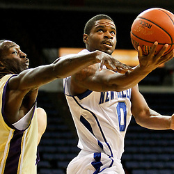 November 27, 2011; New Orleans, LA; New Orleans Privateers guard Brandon Knight (0) shoots past Alcorn State Braves guard Twann Oakley (2) during the first half of a game at the Lakefront Arena.  Mandatory Credit: Derick E. Hingle-US PRESSWIRE