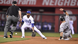 September 11, 2017 - Kansas City, MO, USA - Chicago White Sox's Adam Engel steals second before the throw to Kansas City Royals shortstop Alcides Escobar in the fourth inning during Monday's baseball game on Sept. 11, 2017 at Kauffman Stadium in Kansas City, Mo. (Credit Image: © John Sleezer/TNS via ZUMA Wire)