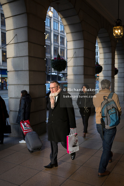 A gentleman walks under the arches of the Ritz Arcade in Piccadilly, on 7th February 2018, in London, England.