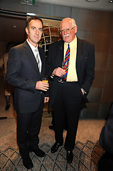 Left to right, ANGUS DEAYTON and BILL TIDY at a tribute lunch in honour of Michael Aspel hosted by The Lady Taverners at The Dorchester, Park Lane, London on 14th November 2008.
