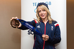 © Licensed to London News Pictures. 25/02/2014. London, UK. Womens snowboard bronze medalist, Jenny Jones shows her medal to the press at the Sofitel Hotel at Heathrow Airport on 24th February 2014. Photo credit : Vickie Flores/LNP