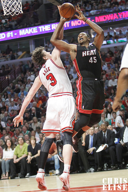 14 March 2012: Miami Heat center Dexter Pittman (45) is fouled by Chicago Bulls center Omer Asik (3) during the Chicago Bulls 106-102 victory over the Miami Heat at the United Center, Chicago, Illinois, USA.