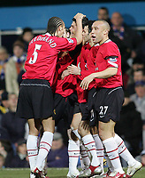 Photo: Lee Earle.<br /> Portsmouth v Manchester United. The Barclays Premiership. 11/02/2006. United's Rio Ferdinand (L) joins in congratulating Cristiano Ronaldo (C) after he scored their second goal.
