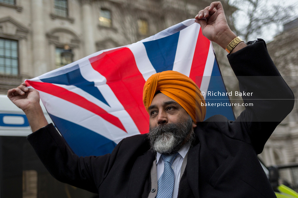 After threee and a half years of political upheavel in the British parliament, a British Sikh and Brexiteers celebrate in Westminster on Brexit Day, the day when the UK legally leaves the European Union, on 31st January 2020, in London, England.