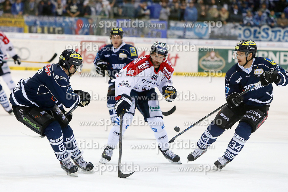 30.11.2014, Saturn Arena, Ingolstadt, GER, DEL, ERC Ingolstadt vs Eisb&auml;ren Berlin, 22. Runde, im Bild Michel Periard (Nr.6, ERC Ingolstadt), Darin Olver (Nr.40, Eisbaeren Berlin) und Benedikt Kohl (Nr.34, ERC Ingolstadt)<br />
