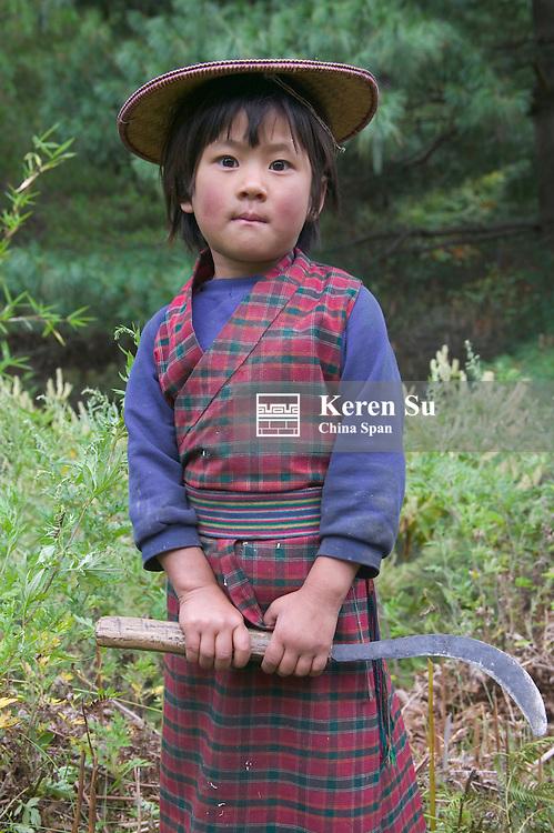 Portrait of a little girl carrying sickle, Bumthang, Bhutan