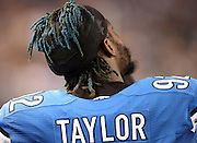 Detroit Lions defensive end Devin Taylor (92) looks on from the sideline with his hair dyed blue during the NFL week 18 NFC Wild Card postseason football game against the Dallas Cowboys on Sunday, Jan. 4, 2015 in Arlington, Texas. The Cowboys won the game 24-20. ©Paul Anthony Spinelli
