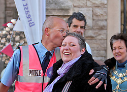 © Licensed to London News Pictures. 16/04/2012. London, U.K..Royal Mail Postman Mike Chandler greets Callie Carling, a visitor to the Haven breast cancer support centre in Fulham, London, after his pre-marathon 150 mile run from the Haven centre in his home town of Hereford to raise £20,000 for the charity. He will also run the London Marathon next Sunday 22nd April..Photo credit : Rich Bowen/LNP