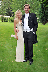 ROB HERSOV and DR KATIE JAMES at the Raisa Gorbachev Foundation fourth annual fundraising gala dinner held at Stud House, Hampton Court, Surrey on 6th June 2009.