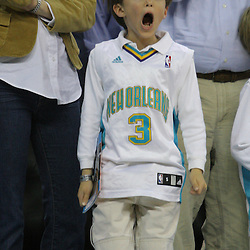 08 February 2009: A young New Orleans Hornets fan jumps and screams as he cheers during a 101-97 win by the New Orleans Hornets over the Minnesota Timberwolves at the New Orleans Arena in New Orleans, LA.