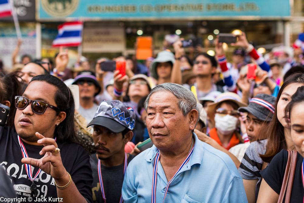 "15 JANUARY 2014 - BANGKOK, THAILAND: Anti-government protestors wait to see Suthep Thaugsuban during a protest march in Bangkok. Tens of thousands of Thai anti-government protestors continued to block the streets of Bangkok Wednesday to shut down the Thai capitol. The protest, ""Shutdown Bangkok,"" is expected to last at least a week. Shutdown Bangkok is organized by People's Democratic Reform Committee (PRDC). It's a continuation of protests that started in early November. There have been shootings almost every night at different protests sites around Bangkok. The malls in Bangkok are still open but many other businesses are closed and mass transit is swamped with both protestors and people who had to use mass transit because the roads were blocked.    PHOTO BY JACK KURTZ"