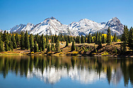 A fresh autumn snow on the San Juan Mountains accents the reflection in Molas Lake.  Molas Lake is on the Million Dollar Highway between Silverton and Durango Colorado