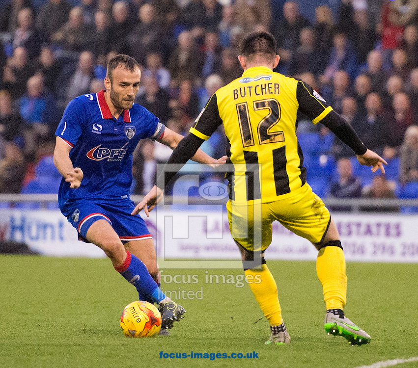 Liam Kelly of Oldham Athletic (left) looks to find a way past Calum Butcher of Burton Albion during the Sky Bet League 1 match at Boundary Park, Oldham<br /> Picture by Russell Hart/Focus Images Ltd 07791 688 420<br /> 31/10/2015