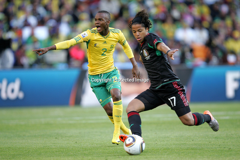 Siboniso GAXA directs the defence as Guillermo FRANCO attacks during the opening match ( match 1) of the FFA World Cup 2010 South Africa held at Soccer City in SOWETO, Johannesburg, South Africa on the 11th June 2010<br /> <br /> Photo by Ron Gaunt/SPORTZPICS
