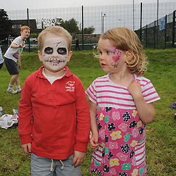 Finn and Ailbhe Duckett enjoying the face-painting  at the official opening of the upgraded courts at Westport Tennis Club on sunday last.<br />