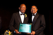 "Col. Frank E. Underwoood accepting the Ebony Bobcat Network Trailblazer award from President Roderick J. McDavis at ""Celebrating Black Heritage at Ohio University Through the Decades"" at the Black Alumni Reunion Gala in Baker Center on September 28, 2013."""
