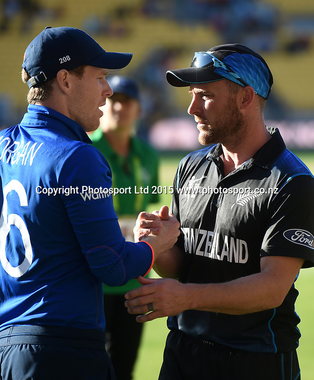 England captain Eoin Morgan and Brendon McCullum to New Zealand at the ICC Cricket World Cup match between New Zealand and England in Wellington, New Zealand. Friday 20 February 2015. Copyright Photo: Andrew Cornaga / www.Photosport.co.nz