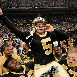 Jan 24, 2010; New Orleans, LA, USA; New Orleans Saints PK Garrett Hartley (5) rides on the shoulders on teammates after kicking a game winning field goal against the Minnesota Vikings in overtime of the 2010 NFC Championship game at the Louisiana Superdome. Mandatory Credit: Derick E. Hingle