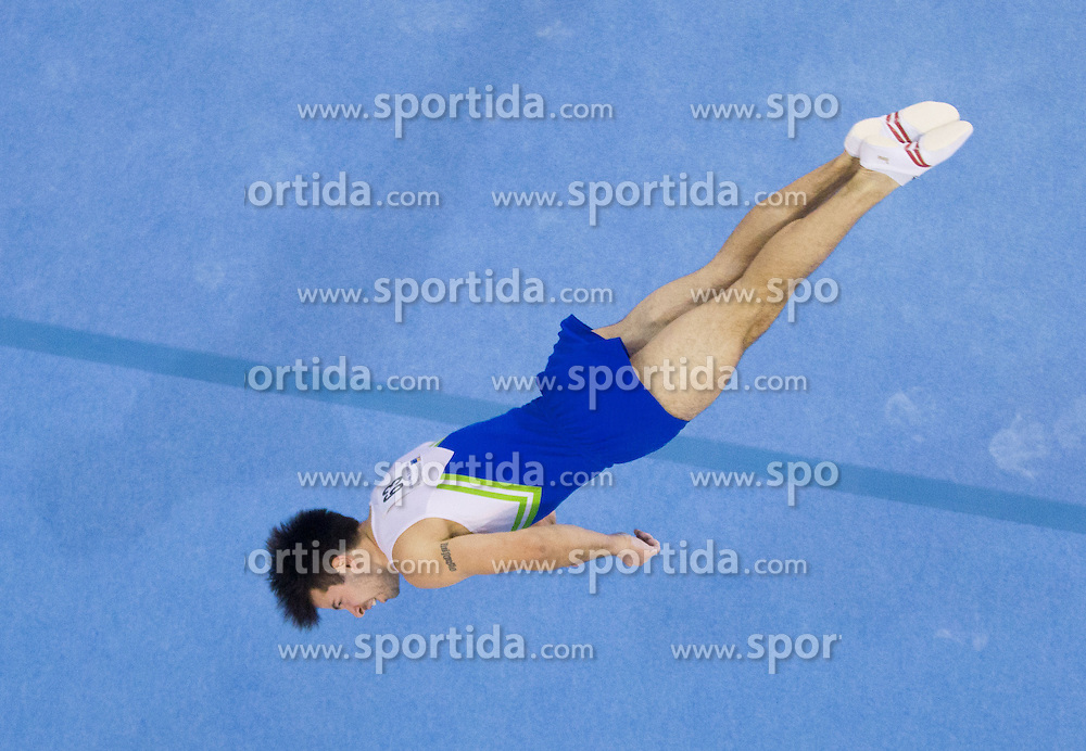 Rok Klavora of Slovenia competes in the Floor Exercise during Final day 1 of Artistic Gymnastics World Cup Ljubljana, on April 27, 2013, in Hala Tivoli, Ljubljana, Slovenia. (Photo By Vid Ponikvar / Sportida.com)
