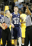 24 JANUARY 2007: Referees call for medical help after Penn State guard Danny Morrissey (33) was poked in the eye while fighting for the ball in Iowa's 79-63 win over Penn State at Carver-Hawkeye Arena in Iowa City, Iowa on January 24, 2007.