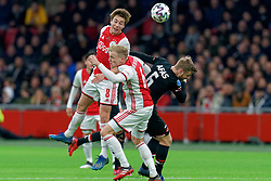 Carel Eiting #8 of Ajax, Donny van de Beek #6 of Ajax and Fredrik Midtsjo #6 of AZ Alkmaar in action during the Dutch Eredivisie match round 25 between Ajax Amsterdam and AZ Alkmaar at the Johan Cruijff Arena on March 01, 2020 in Amsterdam, Netherlands