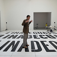 """VENICE, ITALY - MAY 31:  An actor performs in the project  """"The Inadequate"""" by Dora Garcia at the Spanish pavillion at the Giardini Biennale on May 31, 2011 in Venice, Italy. This year's Biennale, the 54th edition, will  officially open  on Saturday June 4th, after several days of press previews, and will run until 27 November"""