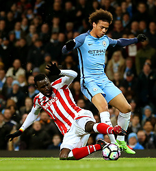 Leroy Sane of Manchester City avoids a tackle from Mame Biram Diouf of Stoke City - Mandatory by-line: Matt McNulty/JMP - 08/03/2017 - FOOTBALL - Etihad Stadium - Manchester, England - Manchester City v Stoke City - Premier League