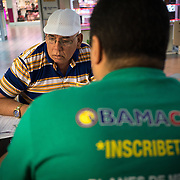 MIAMI, FLORIDA, NOVEMBER 16, 2016<br /> Luis Perez Cuevas, 55,  looks at insurance rates with a licensed insurance agent at the kiosk for Sunshine Health and Life Advisors inside the Mall of the Americas in Miami Dade County. Customers have expressed concerns about &quot;Obama Care&quot; following the election of Donald Trump in the recent presidential elections.<br /> (Photo by Angel Valentin/Freelance)