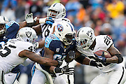NASHVILLE, TN - NOVEMBER 29:  Latavius Murray #28 of the Oakland Raiders runs the ball and runs into Brian Orakpo #98 of the Tennessee Titans at Nissan Stadium on November 29, 2015 in Nashville, Tennessee.  The Raiders defeated the Titans 24-21.  (Photo by Wesley Hitt/Getty Images) *** Local Caption *** Latavius Murray; Brian Orakpo