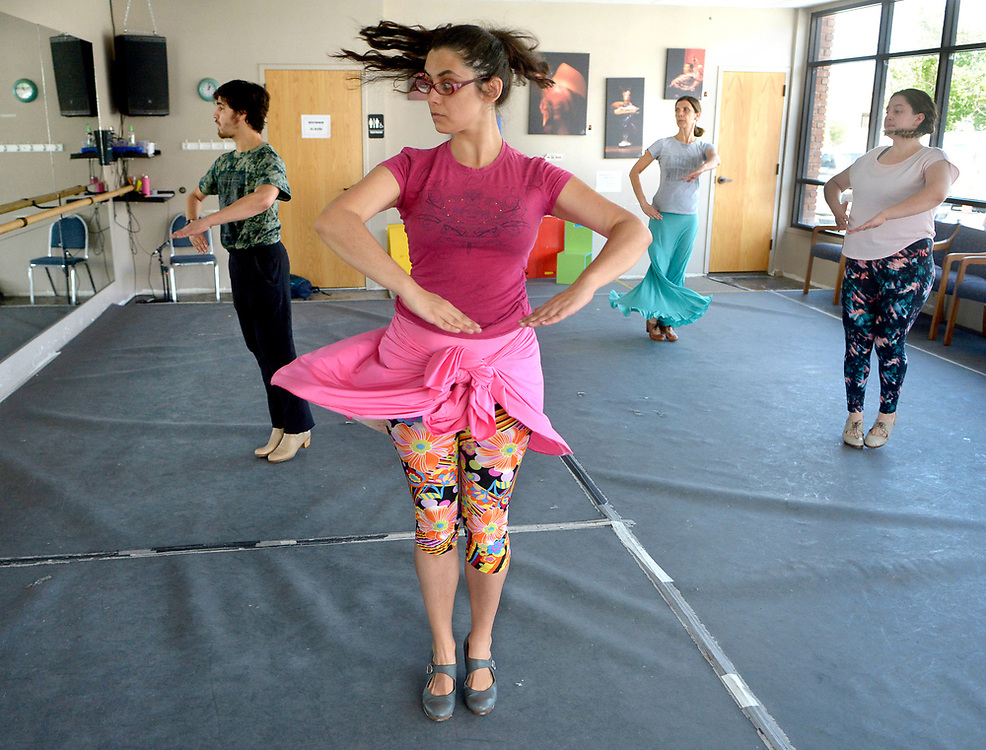 gbs072417g/ASEC -- Instructor Carlos Menchaca, Mariana Rosario, Barbara Gabaldon and Jillian Martinez,   from left, all of Albuquerque, practice pirouettes during the lunch hour drop in class, Flamenco Power Hour, at the Conservatory of Flamenco Arts on Monday, July 24, 2017.  (Greg Sorber/Albuquerque Journal)