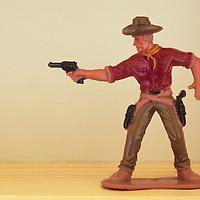 Model cowboy firing gun