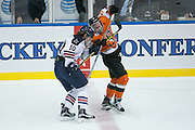 Robert Morris defenseman Tyson Wilson and RIT forward Myles Powell get tangled up during the Atlantic Hockey final at the Blue Cross Arena in Rochester on Saturday, March 19, 2016.