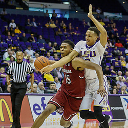 Feb 1, 2017; Baton Rouge, LA, USA; South Carolina Gamecocks guard PJ Dozier (15) is fouled by LSU Tigers guard Brandon Sampson (0) during the first half of a game at the Pete Maravich Assembly Center. Mandatory Credit: Derick E. Hingle-USA TODAY Sports