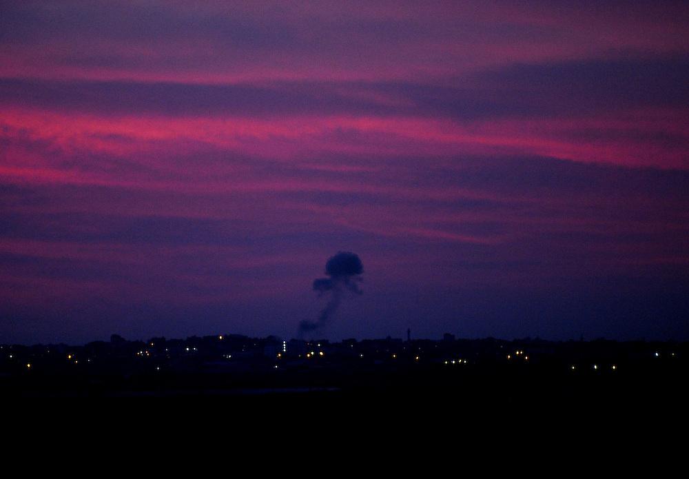 Israel-Gaza border, November 16, 2012: Smoke rises from a building at Northern Gaza Strip after an Israeli Air Force strike as seen from the Israeli border side at the third day of Operation Pillar of Defense. Photo by Gili Yaari  - Israel Photojournalist