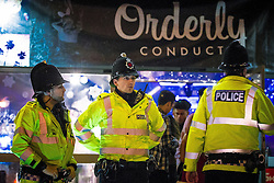 "© Licensed to London News Pictures . 19/12/2015 . Manchester , UK . Police outside the Orderly Conduct event at Deansgate Locks . Revellers in Manchester enjoy "" Mad Friday "" - also known as "" Black Eye Friday "" - the day on which emergency services in Britain are typically at their busiest , as people head out for parties and drinks to celebrate Christmas . Photo credit : Joel Goodman/LNP"