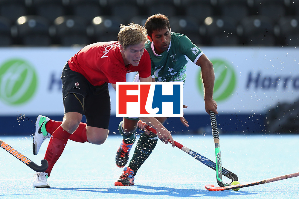 LONDON, ENGLAND - JUNE 16:  Foris Van Son of Canada and Niwaz Ashfaq of Pakistan battle for the ball during the Hero Hockey World League Semi-Final Pool B match between Pakistan and Canada at Lee Valley Hockey and Tennis Centre on June 16, 2017 in London, England.  (Photo by Alex Morton/Getty Images)