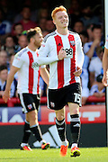 Brentford midfielder Ryan Woods (15)  smiling during the EFL Sky Bet Championship match between Brentford and Ipswich Town at Griffin Park, London, England on 13 August 2016. Photo by Matthew Redman.