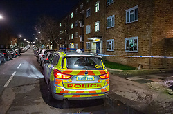 © Licensed to London News Pictures. 09/12/2019. London, UK. A Police car sits outside Shelley House on Boyton Road maintaining a scene watch after a man was fatally stabbed. Metropolitan Police were called by the London Ambulance Service at 18:04GMT on Monday, 9 December to a residential address in Shelley House, Boyton Road N8, following reports of a fight and a man having been stabbed. A man, aged in his 40s, was found suffering from a stab injury. He was pronounced dead at the scene. Photo credit: Peter Manning/LNP