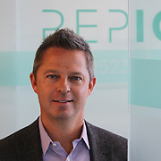 Shawn Carpenter in the REPIQ office Friday July 21, 2017. More/Konstantaras Photography Founded in 2016 by Shawn Carpenter, a serial entrepreneur, and Jonathan Suchland, a former Amazon software development manager, Chicago-based RepIQ crawls the internet to create a database of more than 1 million companies salespeople can tap into, then suggests the best leads to reps.