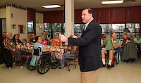 Congressman Frank Guinta addresses questions by residents concerning the heroin problems in Laconia during his visit to the Laconia Housing Authority Sunrise Towers on Thursday afternoon.  (Karen Bobotas/for the Laconia Daily Sun)