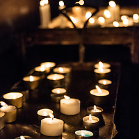 Votive candales in a catholic church.