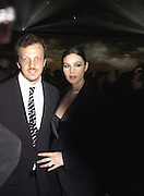 Gabriele Muccino and Monica Bellucci, Party to celebrate 100 years of the Santos  de Cartier watch. Le Bourget airport. Paris. 7 April 2004. ONE TIME USE ONLY - DO NOT ARCHIVE  © Copyright Photograph by Dafydd Jones 66 Stockwell Park Rd. London SW9 0DA Tel 020 7733 0108 www.dafjones.com