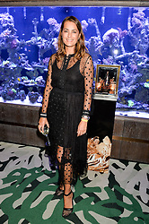YASMIN LE BON at a dinner hosted by Creme de la Mer to celebrate the launch of Genaissance de la Mer The Serum Essence held at Sexy Fish, Berkeley Square, London on 21st January 2016.
