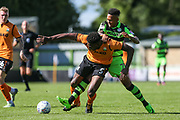 Forest Green Rovers Keanu Marsh-Brown(7) tussles with Barnet's Ricardo Santos(5) during the EFL Sky Bet League 2 match between Forest Green Rovers and Barnet at the New Lawn, Forest Green, United Kingdom on 5 August 2017. Photo by Shane Healey.